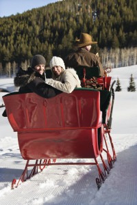 couple on romantic winter horse sleigh ride