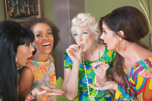 laughing group of middle aged women smoking marijuana at a party